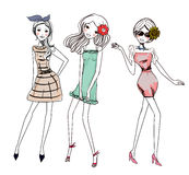 Three fashion girls Stock Photos