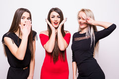 Three fashion models in  night dresses have fun on camera. Stock Photo