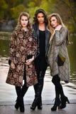 Three fashion models posing at Central Park for fall fashion photo shoot. Royalty Free Stock Photos