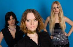 Three fashionable girls stock photo