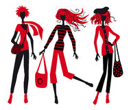 Three fashionable girls Stock Photos