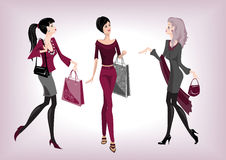 Three fashionable women Stock Photo