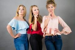 Free Three Fashionable Women Thinking Stock Photography - 117184042