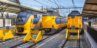 Three Fast Intercity Commuter Trains waiting at a station Royalty Free Stock Photos
