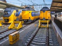Three Fast Modern Passenger Commuter Transport Trains waiting at Stock Photos