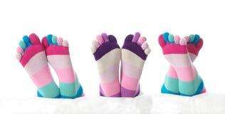 Three feet in stockings Royalty Free Stock Image