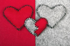 Three felt hearts on two different backgrounds Stock Photos