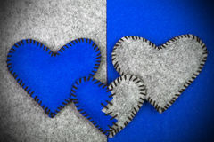 Three felt hearts on two different backgrounds Stock Image