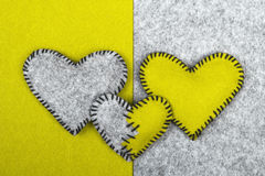 Three felt hearts on two different backgrounds Royalty Free Stock Photo