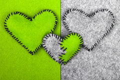 Three felt hearts on two different backgrounds, Royalty Free Stock Photos