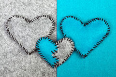 Three felt hearts on two different backgrounds Stock Photography
