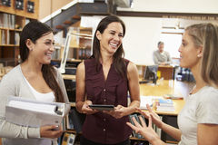 Three Female Architects Chatting In Modern Office Together Royalty Free Stock Photo