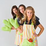 Three female cooks greeting Stock Images