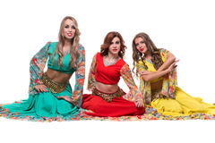 Three female dancers posing, isolated on white in Royalty Free Stock Photo