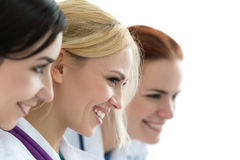 Three female doctors looking at monitor Stock Photos