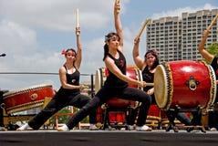 Three female drumers in Taiko performance stock photography