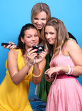 Three female friends with a camera Stock Image