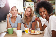 Three Female Friends Enjoying Breakfast At Home Together Royalty Free Stock Image