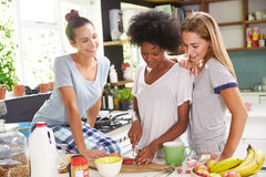 Three Female Friends Enjoying Breakfast At Home Together Royalty Free Stock Photos