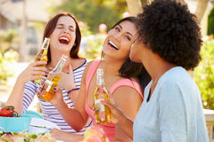 Three Female Friends Enjoying Meal At Outdoor Party Royalty Free Stock Image