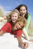 Three female friends having fun at beach stock images
