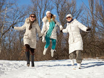 Three female friends having fun on winter day royalty free stock photo
