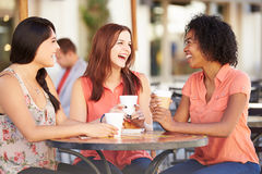 Three Female Friends Meeting In CafŽ Stock Images