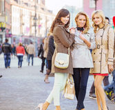 Three female friends in the old town Royalty Free Stock Image