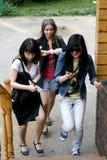 Three female friends rushing Royalty Free Stock Image