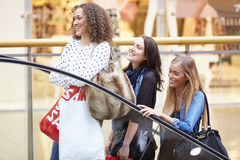 Three Female Friends Shopping In Mall Together Stock Images