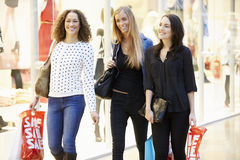 Three Female Friends Shopping In Mall Together Stock Image