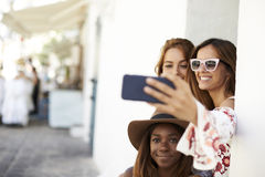 Three female friends taking a selfie in the street, Ibiza Stock Photos