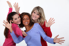 Three female friends waving Royalty Free Stock Images