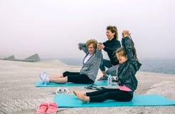 Three female generations exercising Stock Image