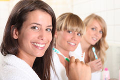 Three female house mates Royalty Free Stock Photos