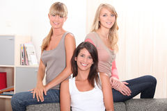 Three female housemates Royalty Free Stock Photography