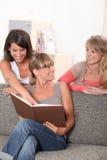 Three female housemates Stock Image