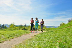 Three Female Joggers running together outdoors Royalty Free Stock Image