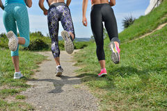 Three Female Joggers running together outdoors Royalty Free Stock Photos