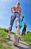 Three Female Joggers running together outdoors Stock Image