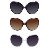 Three female pairs of sunglasses Royalty Free Stock Photos