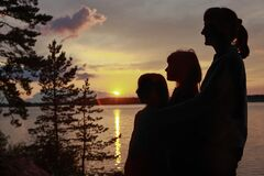 Three female seluets at sunset background. people live in unity with nature.