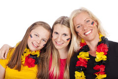 Three female soccer fans Royalty Free Stock Photography