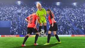 Three female soccer players during struggling for the ball. During the soccer math Royalty Free Stock Photo