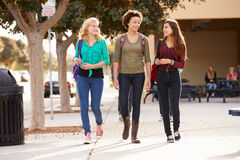 Three Female Students Walking To High School Royalty Free Stock Image
