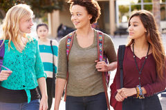 Three Female Students Walking To High School Royalty Free Stock Photography