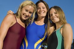 Three female swimmers smiling Royalty Free Stock Image