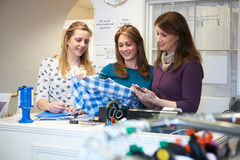 Three Female Volunteers Workers In Charity Shop stock images