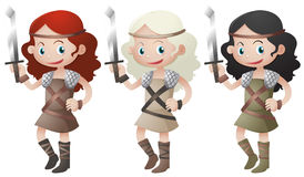 Three female warriors holding swords Royalty Free Stock Photography
