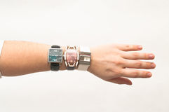 Three female wristwatches on hand Royalty Free Stock Image
